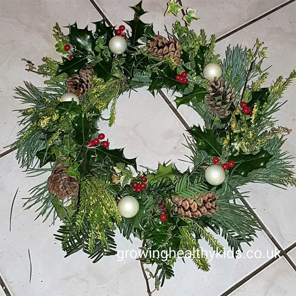 step by step guide to making a christmas wreath fun craft ideas to make decorations and gifts for your friends and family using materials from your garden or recycling bag such as mason jars, Perfect way to craft with the kids and make beautiful gifts too.