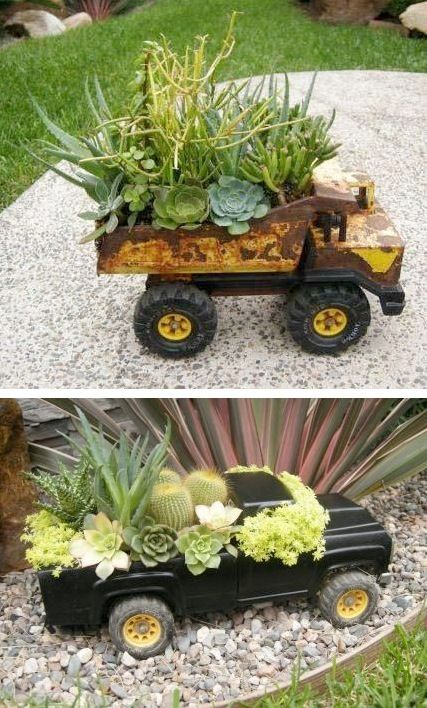 Old toy trucks being used as planters for succulents