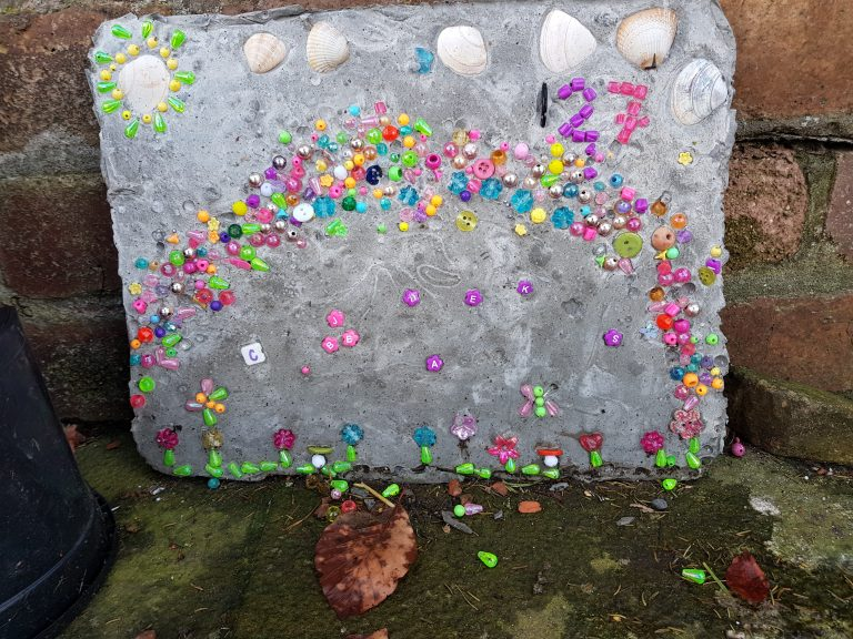 Find out how to make your own cake pans cement stepping stones with kids. We love fun garden crafts like this, they're so versatile whether you decorate them using handprints, beads, stained glass, or just paint them.
