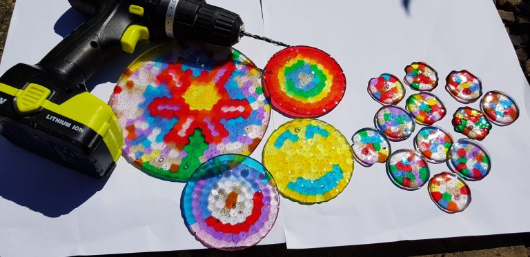 Making suncatchers with pony beads