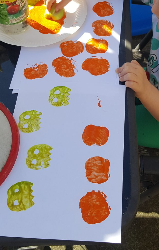 Use apples to make fantastic ghosts and pumpkins. Great idea for wrapping paper or cards for Halloween.