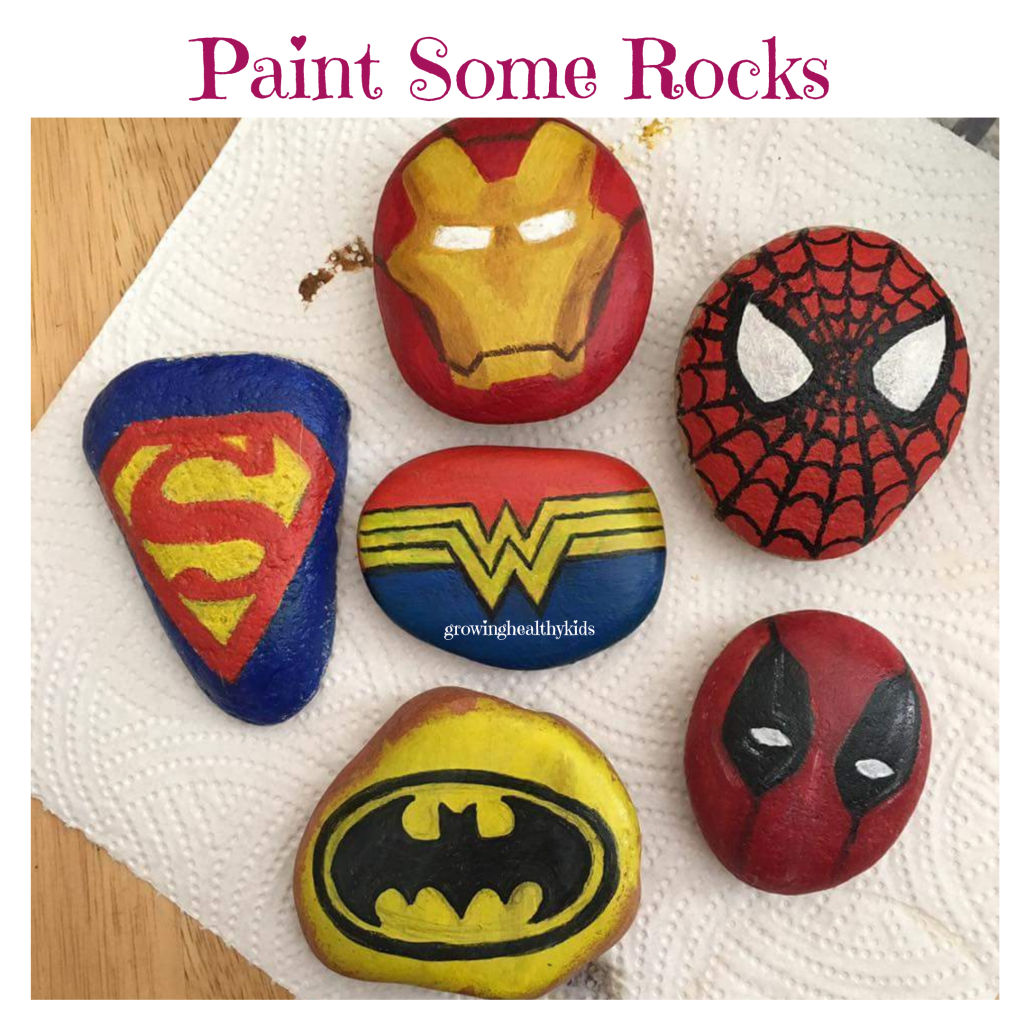 Painting rocks is a fun activity to do outdoors in your back yard.