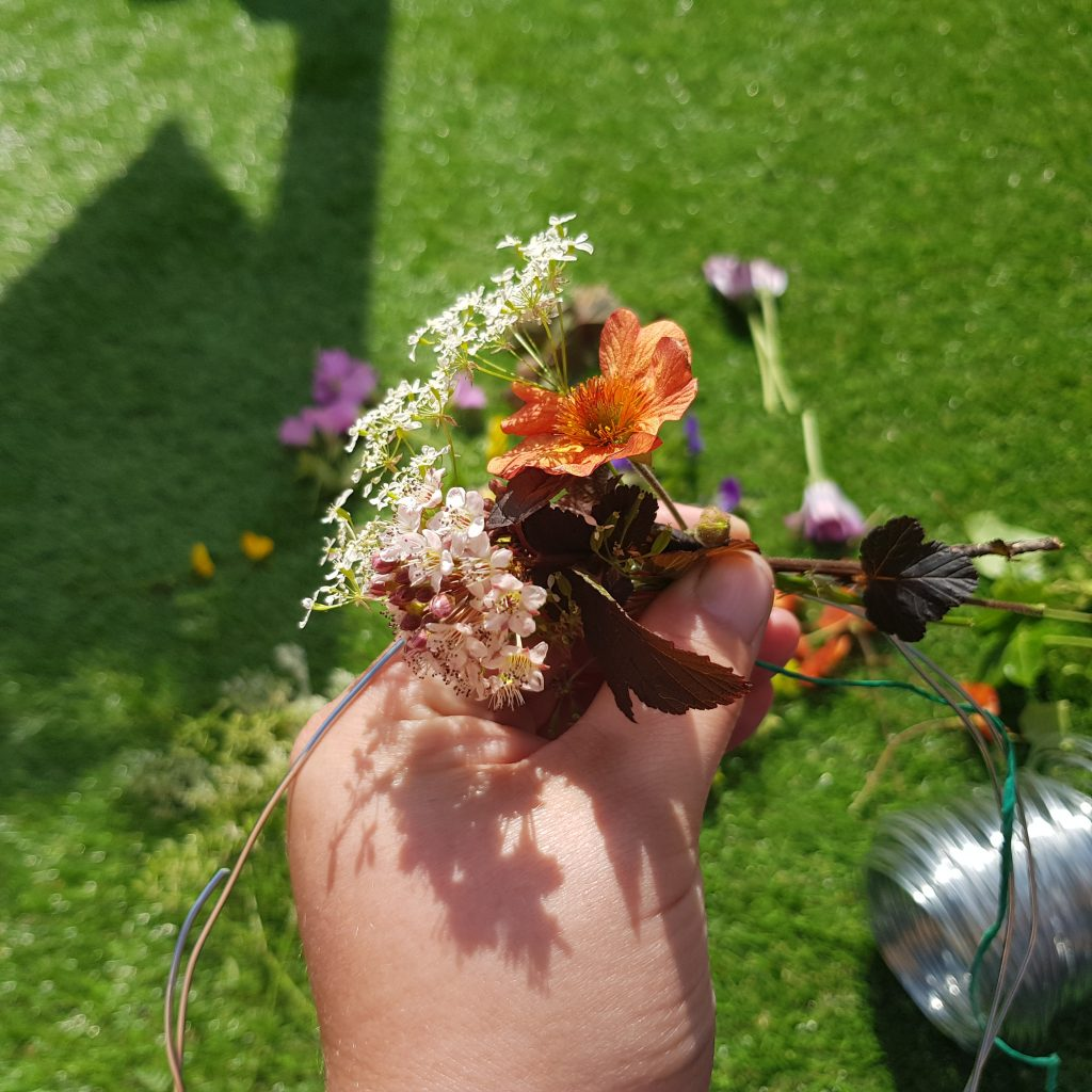 Flower crowns are a fun, simple and beautuful craft to try with your kids. Easy way to brighten their hair for any party and a fun way to spend time together using flowers from your garden.