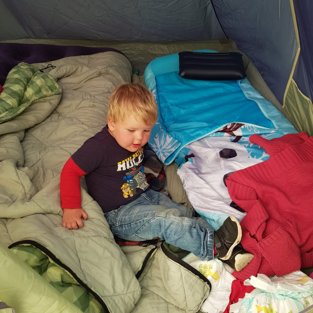 Essentials for camping with kids for the 1st time. Great tips from what tent to sleeping gear, set up and things to take for toddlers. A great list of ideas and hacks, food and there is even a printable checklist