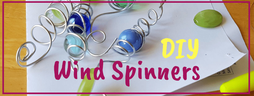 Wire spiral wind spinner with marble