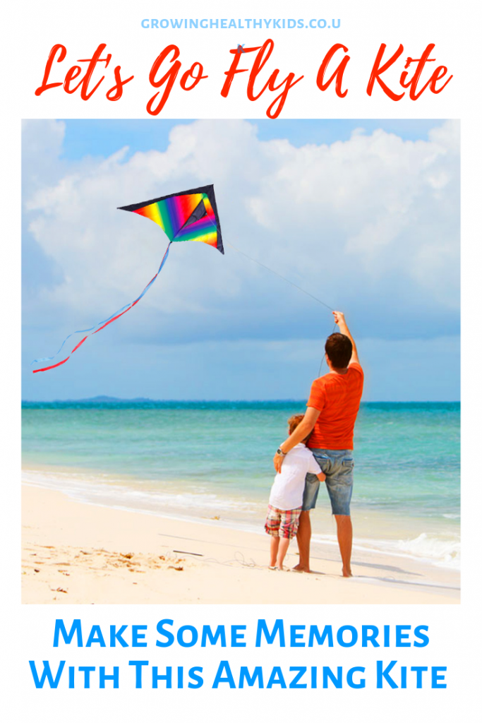 Family flying a kite on the beach. Showing a great kite for kids.