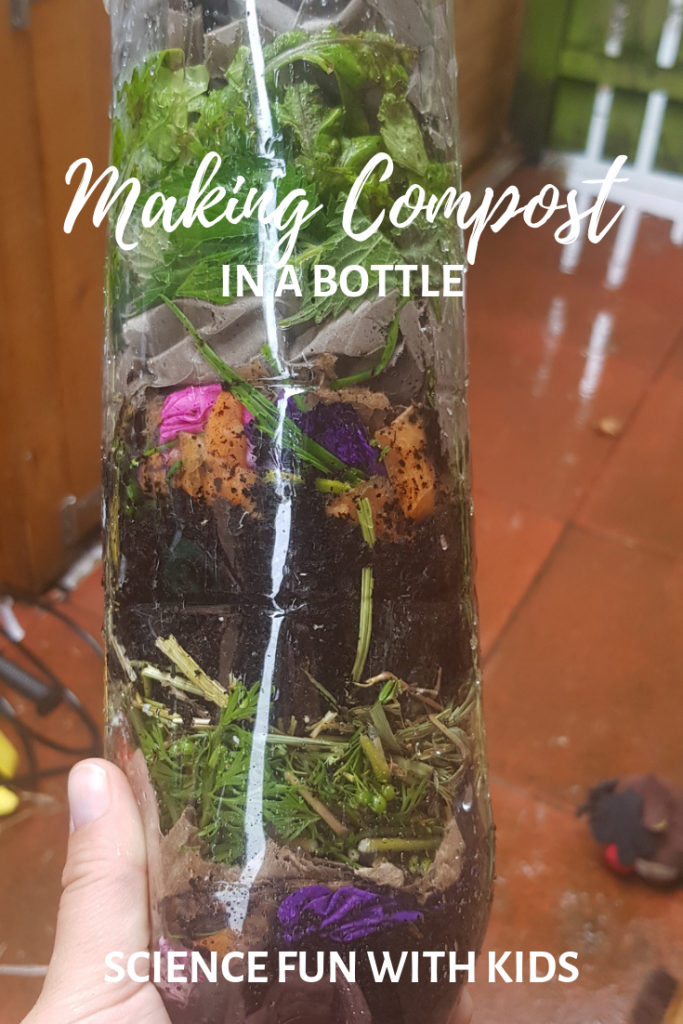 Soda bottle full of layers of composting materials