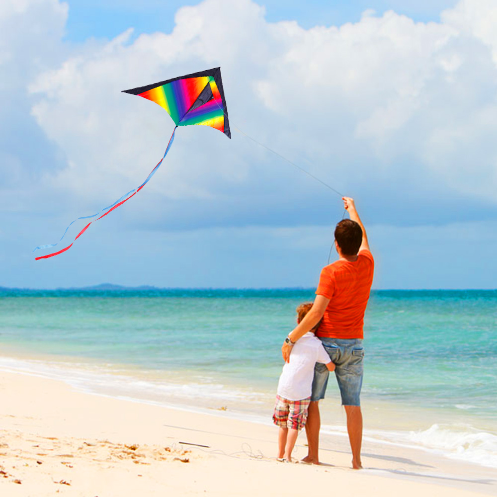 Family flying kite high in the sky with kid. On a beach, kite for kids