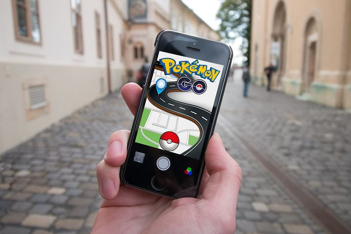 Apps on phone include pokemon