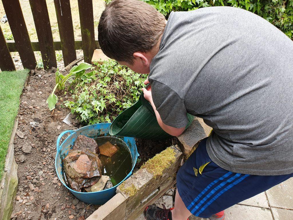 fillling our garden pond for wildlife makes gardening fun for kids
