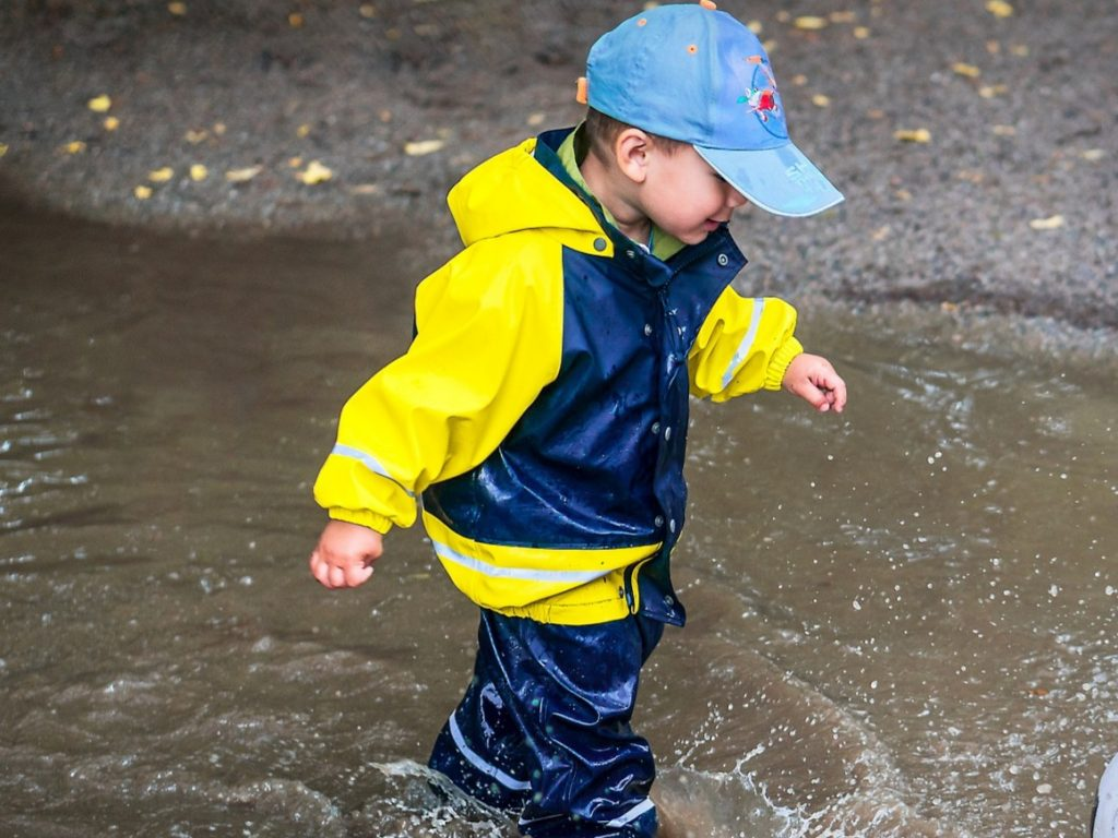 Boy Splashing in puddles